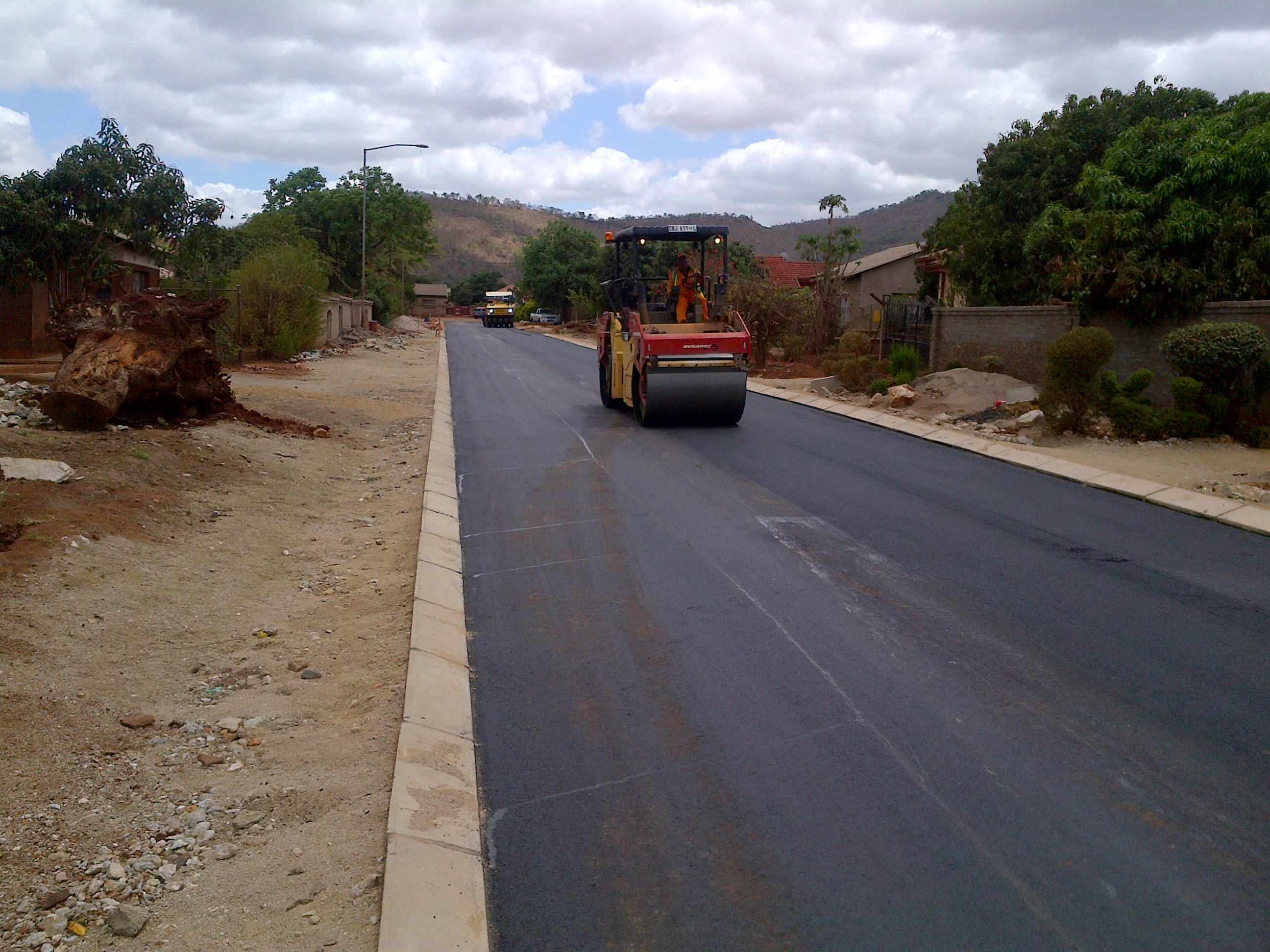 SES 010 P12 Compaction Of Surfacing In Progress